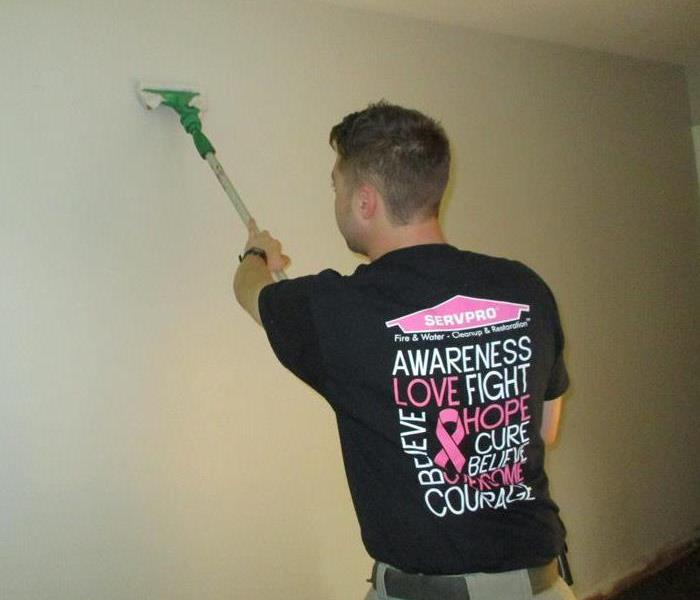 SERVPRO team member wearing a Pink SERVPRO logo to promote breast cancer awareness month within our community