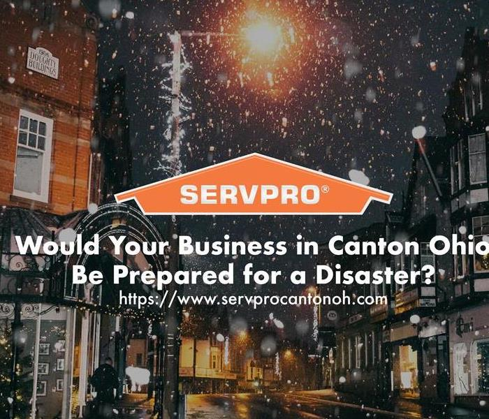 Orange SERVPRO  house logo on image of city in winter with snow.