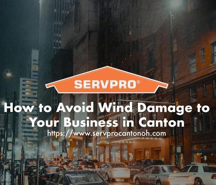 Orange SERVPRO  house logo on image with winter windy day with business downtown.