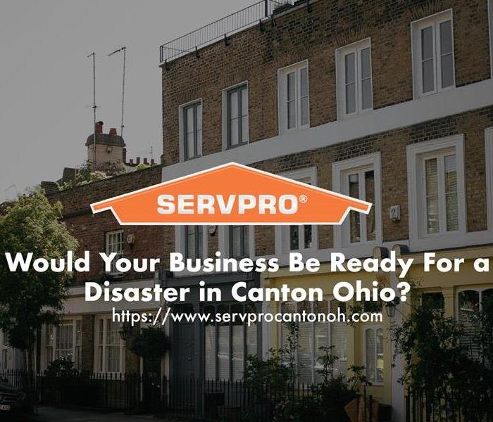 Orange SERVPRO house logo on image with commercial buildings